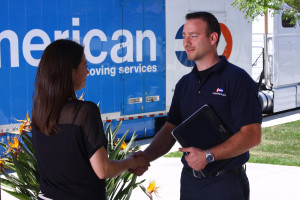 A photograph of a Capitol mover shaking hands with a client