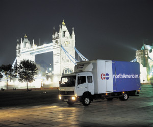 A photograph of a northAmerican moving van on a street in London, England