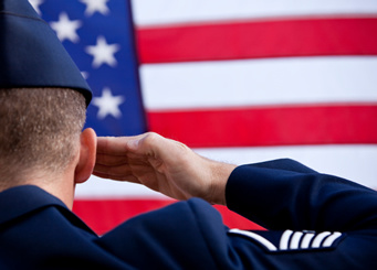Photograph of a soldier saluting the American flag