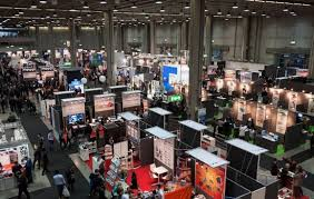 A photograph of different trade show booths at a convention