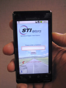 A photograph of the STI app on a smart phone
