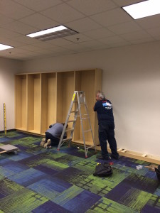 A photograph of Capitol employees assembling shelves