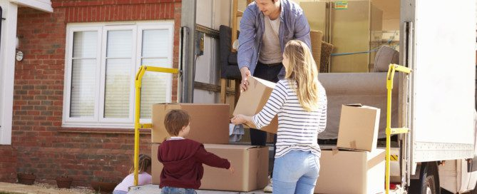 family moving home items with a moving company