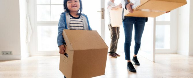 Young family in the process of eco-friendly move with a moving company