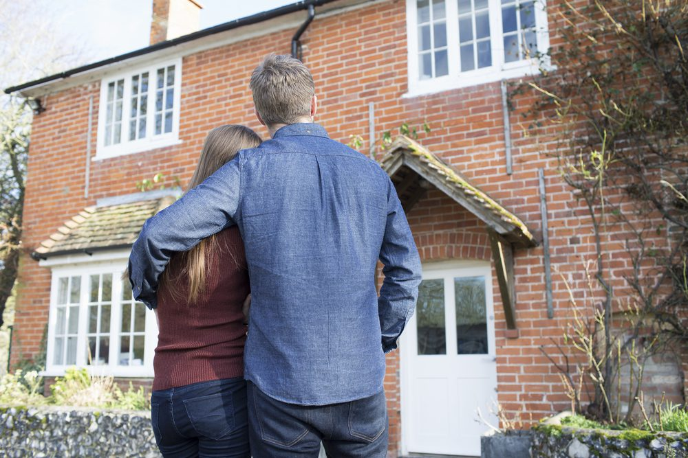homeowners looking at newly purchased home